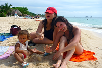 Playa Blanca Cartagena Colombia ladies relaxing on the beach.png