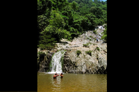 Couple Wading in Quebrada Valencia Waterfalls Santa Marta Colombia
