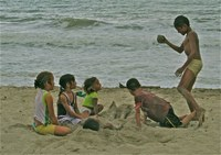 children playing at Palomino Beach in Colombia