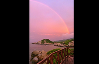rainbow at sunset at san juan tayrona national park santa marta colombia.png